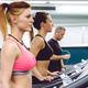 People training over treadmills on fitness center - PhotoDune Item for Sale