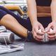 Sportswoman sitting on the gym floor - PhotoDune Item for Sale