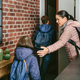 Family with emergency backpacks leaving their front door quickly - PhotoDune Item for Sale
