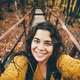 Traveler woman in yellow sweater takes selfie for travel blog. - PhotoDune Item for Sale
