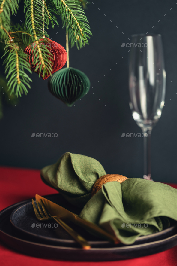 Christmas Table Setting with Spruce Branches in Deep Color Palette. - Stock Photo - Images