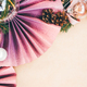 Christmas composition. Christmas pink decorations on craft background. - PhotoDune Item for Sale