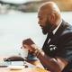 Black man with laptop in street bar - PhotoDune Item for Sale