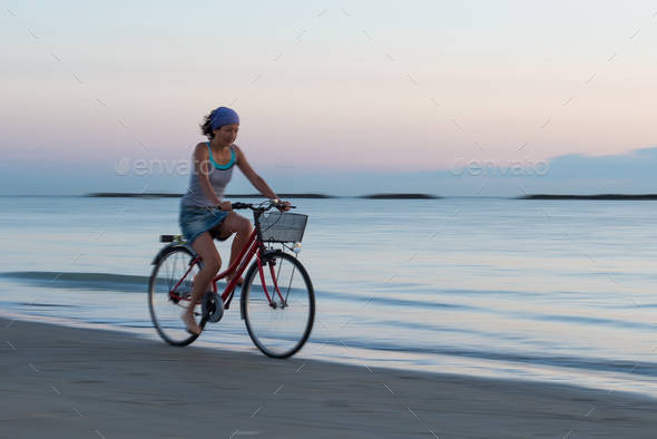 Young woman during a bicycle - Stock Photo - Images