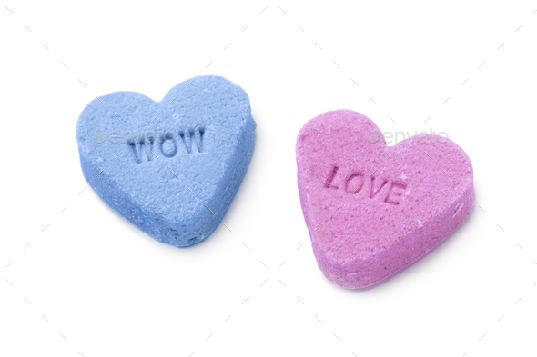 Heart shaped sweet candy with text on white background - Stock Photo - Images