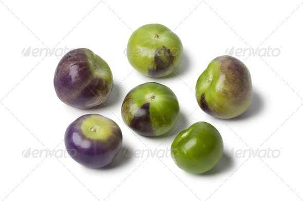 Fresh purple and green tomatillos - Stock Photo - Images