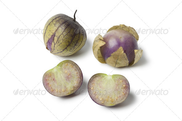 Fresh whole and half tomatillos - Stock Photo - Images