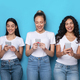 Five Happy Multiracial Females Using Phones Standing On Blue Background - PhotoDune Item for Sale