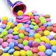 Multicolored glazed chocolate candies out of the container - PhotoDune Item for Sale