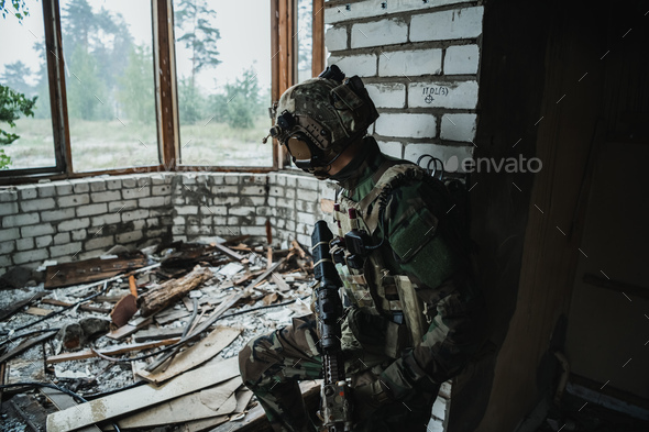 Soldier preparing tactical gear for action battle - Stock Photo - Images