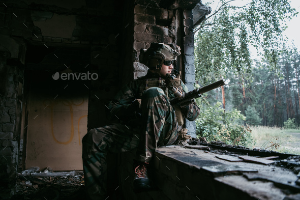 Soldier talking on the walkie-talkie inside the building, military concept - Stock Photo - Images