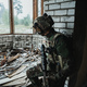 Soldier preparing tactical gear for action battle - PhotoDune Item for Sale