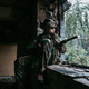 Soldier talking on the walkie-talkie inside the building, military concept - PhotoDune Item for Sale