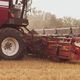 Combine harvester in the field. Close-up of a reel. Harvesting season. Rye and barley - PhotoDune Item for Sale