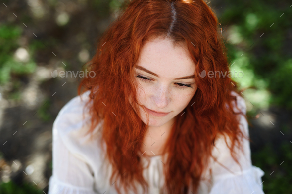 Close-up portrait of sad young woman outdoors in city - Stock Photo - Images