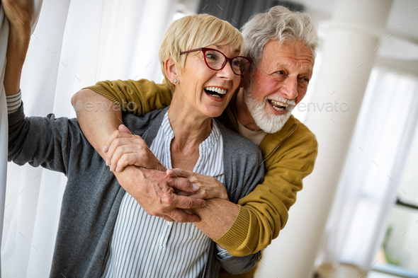 Happy senior couple in love hugging and bonding with true emotions - Stock Photo - Images