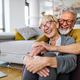 Happy senior couple in love hugging and bonding with true emotions - PhotoDune Item for Sale