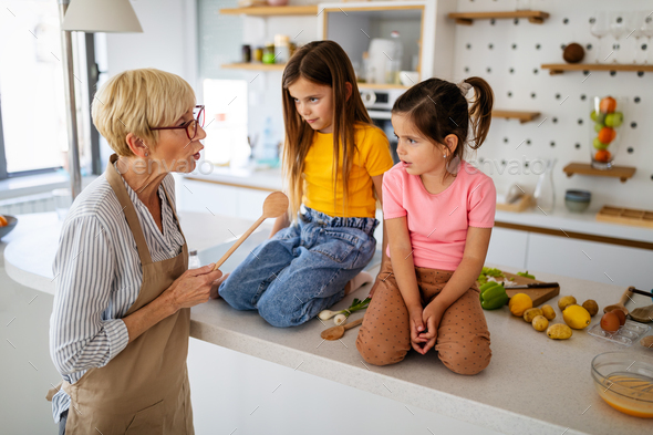 Grandmother is scolding her grandchildrens girls. Family, punishment, discipline concept - Stock Photo - Images