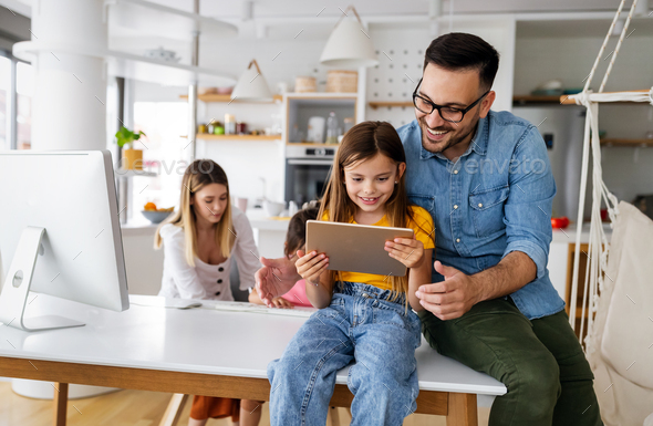 Parents helping to children studying online at home. Lockdown and online school, technology concept - Stock Photo - Images