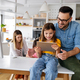 Parents helping to children studying online at home. Lockdown and online school, technology concept - PhotoDune Item for Sale