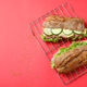 Baking rack with ciabatta sandwiches on red background - PhotoDune Item for Sale