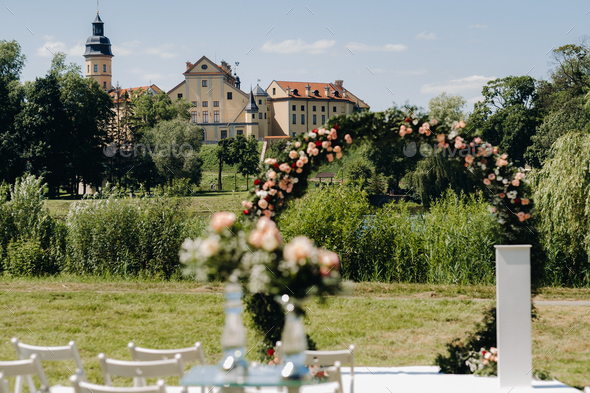 Wedding ceremony on the street on the green lawn near the Nesvizh Castle.Belarus - Stock Photo - Images