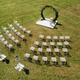 Wedding ceremony on the street on a green lawn with white chairs - PhotoDune Item for Sale