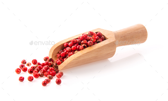pink peppercorn  in wood scoop isolated on white - Stock Photo - Images