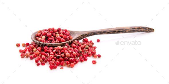 dried pink peppers in wood spoon isolated on white - Stock Photo - Images