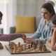 Girls playing chess together at home - PhotoDune Item for Sale