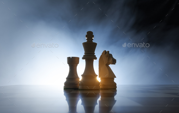 Chess pieces on the chessboard - Stock Photo - Images