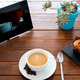 Sweet goodmorning on a wooden table prepared with hot coffee, and a chocolate cupcake. - PhotoDune Item for Sale