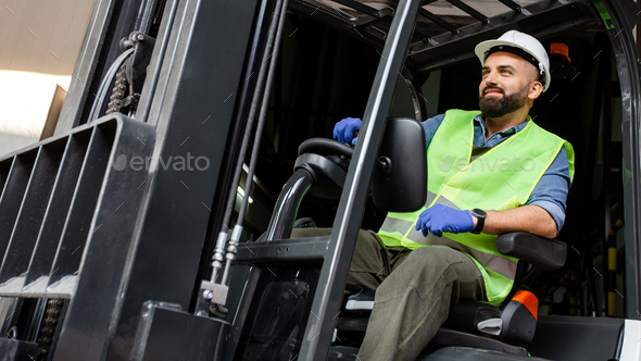 Work in warehouse, loading products for production on plant, logistics and delivery - Stock Photo - Images