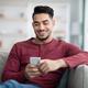 Happy arab man enjoying new mobile application - PhotoDune Item for Sale