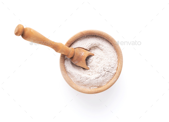 Wheat flour powder in bowl dish and wooden scoop for bread cooking isolated on white background - Stock Photo - Images