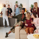 Happy young intercultural women with flutes of champagne enjoying home party - PhotoDune Item for Sale
