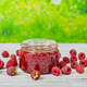 Jam and raspberries on a light wooden table - PhotoDune Item for Sale