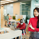 Young smiling businesswoman of Asian ethnicity crossing her arms by chest - PhotoDune Item for Sale