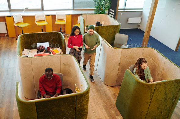 Several young intercultural co-workers in casualwear working individually - Stock Photo - Images