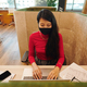 Asian young businesswoman in smart casualwear and protective mask networking - PhotoDune Item for Sale