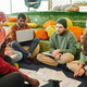 Group of intercultural financial managers brainstorming and discussing papers - PhotoDune Item for Sale