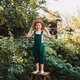 Little farmer in green overalls, standing in garden with happy face, in straw hat - PhotoDune Item for Sale