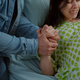 Woman in pain from childbirth holding hands with husband - PhotoDune Item for Sale