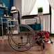 Hospital medial wheelchair standing in empty living room with nobody in it - PhotoDune Item for Sale
