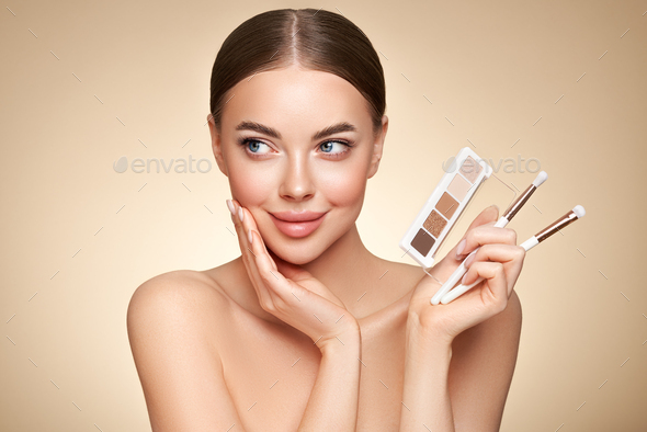 Beauty woman with eye shadow makeup palette - Stock Photo - Images