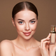 Portrait beautiful young woman with foundation bottle - PhotoDune Item for Sale