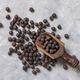 Black chickpea on the wooden scoop top view - PhotoDune Item for Sale