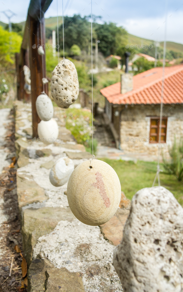 Wooden railing with hanged stones - Stock Photo - Images
