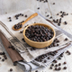 Wooden bowl of black chickpea with spoon closeup - PhotoDune Item for Sale