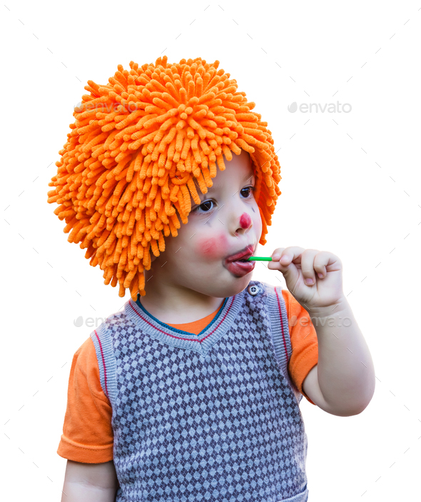 Clown child eating a lollipop on white background - Stock Photo - Images